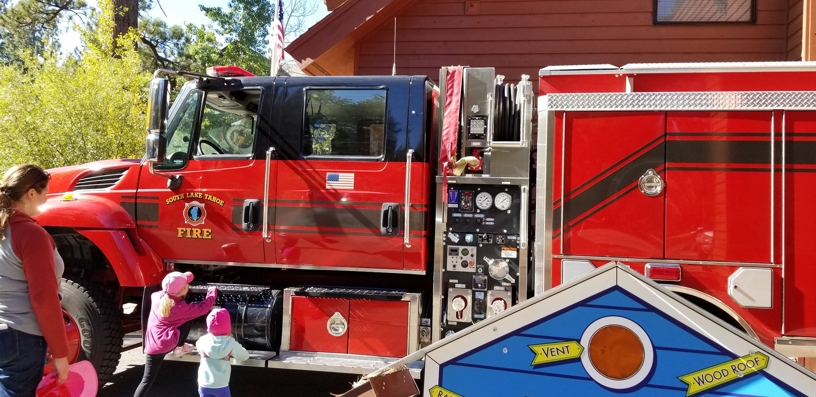 kids looking at the fire engine during open house
