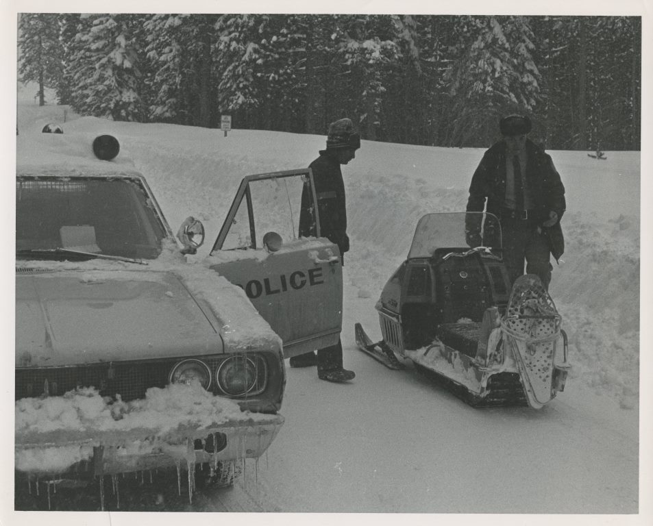 19xx Police Car and Snow Mobile in Snow.jpg